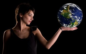 Woman Holding The Earth In Her Hand
