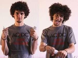 Two men depicting AC DC