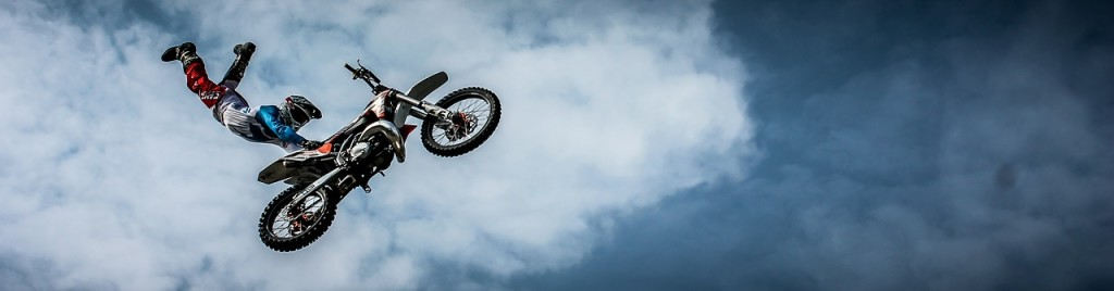 motorcyclist flying through the sky