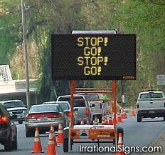 photo of a traffic sign - Stop Go Stop Go