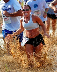 Woman racing in mud