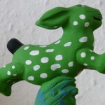 green bunny with white spots
