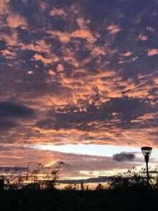 Scorpio, clouds, sunset